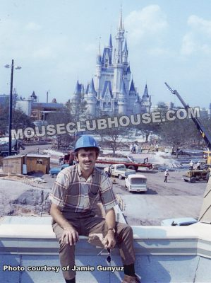 Jamie Gunyuz in front of Cinderella Castle in Walt Disney World, still under construction