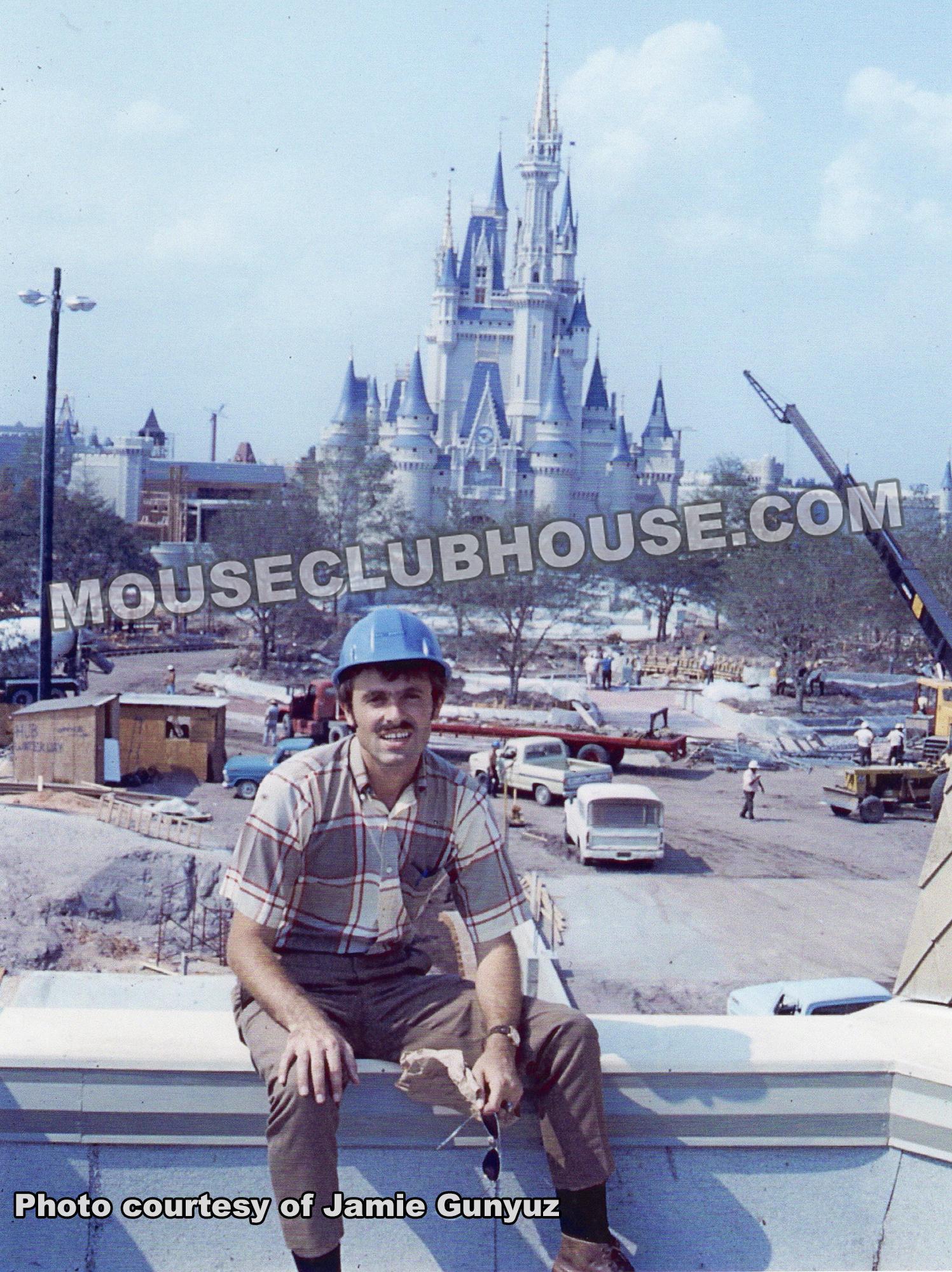 Jamie Gunyuz in front of Cinderella Castle in Walt Disney World, still under construction